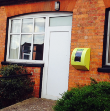 Defibrillator mounted on Village Hall wall